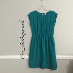 Teal Dress Beautiful jewel toned teal dress. Great for the office or a night out on the town. Can be dressed up or dressed down. Worn twice. Has an elastic waist. I will be happy to answer any questions over this dress. Just ask. Open to reasonable offers Old Navy Dresses