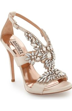 Elevate any look with these Badgley Mischka crystal embellished platform sandal. A dazzling array of mixed crystals blooms across the V-cut straps in lustrous satin.