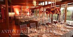 DRAMATIC OPULENCE // Designed for the wedding of Corine & Jannie held at Forum Homini and Rootz Restaurant outside of Johannesburg.  Silver Candelabra were transformed with packed floral arrangements for center pieces:  DECOR DESIGN // APR Bespoke WEDDING EMPORIUM South Africa