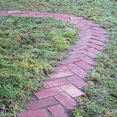 An easy DIY tutorial to make a simple herringbone pattern reclaimed brick garden path in your own backyard. #gardenpaths