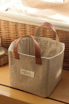 Love these totes for organizing - get on Etsy, made by a Chinese designer.  Lovely (leather and natural fiber).