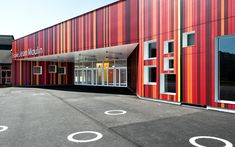 prinvault architectes resurrect the scorched jean moulin school - striped facade