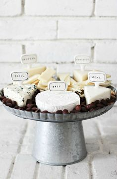 Create a cheese board for your party with crowd pleasing cheese and some more exotic ones. Get creative with how you label them: use toothpick flags or use a slate board that you can write on in chalk!