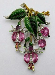 Exquisite Alfred Philippe for TRIFARI 1942 enamel and demilune crystals 'Fuchsia' clip/pin. Features detailed two-tone green enamel
