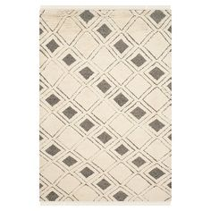 Inspired by traditional Kenyan textiles, this hand-woven wool rug brings a well-traveled look to any room.  Product: Rug