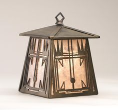 7.5 Inch W Southwest Hanging Wall Sconce - 7.5 Inch W Southwest Hanging Wall SconceA handsome Southwest Native American pattern is depicted on this lantern wall sconce handcrafted in the USA by Meyda artisans. This fixture is finished in Antique Copper and has Silver mica panels. Theme: RUSTIC LODGE Product Family: Southwest Product Type: WALL SCONCES Product Application: WALL SCONCE -- ONE LIGHT Color: ANTIQUE COPPER/SILVER MICA Bulb Type: MED Bulb Quantity: 1 Bulb Wattage: 60 Product…