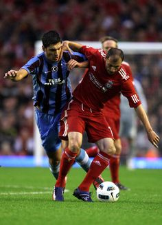 Milan Jovanovic of Liverpool battles with Ceyhun Gulselam of Trabzonspor during the UEFA Europa League play-off first leg match beteween Liverpool and Trabzonspor at Anfield on August 19, 2010 in Liverpool, England. - 2 of 46