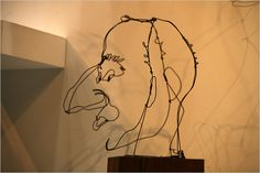 """Calder portrait at the Whitney - """"wire was like three-dimensional ink; it was a means of combining drawing and sculpture in space."""""""
