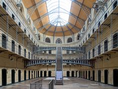 Find out how Kilmainham Gaol in Dublin became one of Ireland's most important historical sites, after being abandoned for thirty-four years. Whiskey Tour, Kilmainham Gaol, Abandoned Prisons, Georgian Architecture, Dublin Ireland, Historical Sites, The Good Place, National Parks, Abandoned Homes