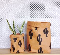 Featuring a hand printed CACTUS image, this bag is sure to impress all the cactus lovers.LARGE IS ON THE RIGHT OF THE PICTURE. This storage bag is made from an engineered fabric/washable paper that can be rolled, scrunched, folded ... Use your imagination. The feel of this bag is somewhere between leather and thick paper. Just like a good pair of jeans, this bag will 'wear in' and become more pliable and individual the more you use it. Please note, it does not feel like thin...