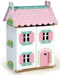 - fully painted & decorated wooden dollhouse - 25+ pieces of wooden furniture and accessories as shown - removable roof panels - opening shutters, windows, & doors - heart motif and door surround - ea