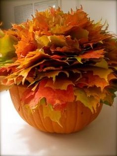 """""""LEAFBOWL"""". .... Cut the top off of a small pumpkin and let inside dry out (after cleaning out the goo of course!). Add a bit of floral foam inside for a foundation, then poke leaves into the foam – the more you poke the prettier and fuller it looks!"""