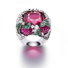 Raspberry daiquiri inspiration ring from the Limelight Cocktail collection in 18K white gold set with 91 brilliant-cut diamonds, 1 cushion-cut rubellite, 3 carved rubellites and 147 round emeralds by Piaget