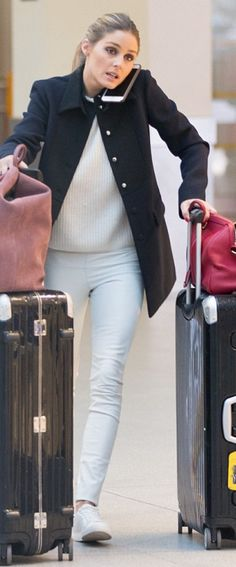Who Made Olivia Palermo S White Sweater Sneakers Pink Suede Bag Red Handbag And Black Luggage