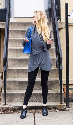 Wrap sweater, ankle boots, pop of blue, messy curls.