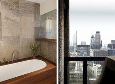 Retrouvius, Lauderdale Tower, Barbican, London, iroko hardwood bathtub, fossil limestone tiles, view of London
