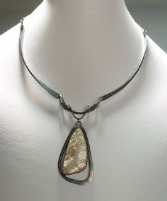 James Frappe: Necklace, Sterling silver and fossil - impression of tiny seashell in the fossilized stone.