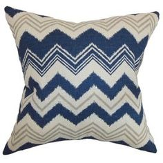 """Cotton pillow with a chevron motif. Made in the USA.   Product: PillowConstruction Material: Cotton cover and feather-down fillColor: Blue, natural and birchFeatures:  ReversibleInsert includedClean knife-edge finishMade in the USA Dimensions: 18"""" x 18""""Note: Dry cleaning recommended"""