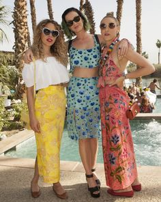 Pool party style with Cleo Wade wearing the Jimmy Choo Rebel bag and Mia Moretti wearing the Ruby bag