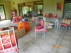 Front veranda - a feast of burnt orange, reds and an inviting space - though needs to be redecorated and sorted out now - June 2014