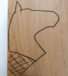 The drawing should be arranged on the wood so that the grain direction is running from the bottom to the tip of the ears. This will lessen the likelihood of these getting broken during the carving process. The rest of the head should not be affected by having short grain anywhere