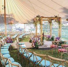 Colourful Rustic theme marquee for an outdoor wedding Source: theknot