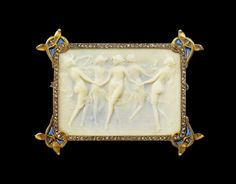 René Lalique Dancing Nymph Cameo brooch. The rectangular gold plaque encloses a scene of five nymphs, hands joined in a circle, light draperies floating as they move round. The figures stand out against the ground which is stained a pale dreamy blue. The rose diamond border is embellished at the four corners with a gold motif containing a piece of mistletoe with dark blue plique à jour enamel. René Lalique of Paris, 1898-9.