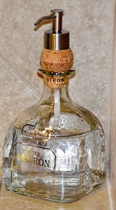 Things To Do With A Leftover Liquor Bottle I love the idea of putting the dispenser through a cork - so easy! Cute for sanitizer in the man cave!I love the idea of putting the dispenser through a cork - so easy! Cute for sanitizer in the man cave! Cork Crafts, Diy Crafts, Shell Crafts, Liquor Bottle Crafts, Liquor Bottle Lights, Crafts With Bottles, Empty Liquor Bottles, Decorating With Glass Bottles, Alcohol Bottle Decorations