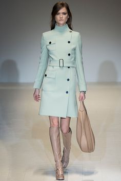This look from Gucci's Fall 2014 Ready To Wear Collection is the embodiment of '60s mod style. The impeccable blend of soft pastels with neutral knee-high boots, are some of the most coveted essentials in recreating a mod inspired look.