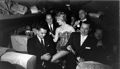 Group of businessmen on their way to the Gaslight Club, 1952, Chicago, Stan Wayman.  The Gaslight was Hugh Hefners inspiration for the Playboy Club. Both were on E Walton.  Instead of bunnies, the theme was the Gay '90's (1890's). The private, members only club, played Dixieland and Ragtime Jazz, had comedy acts and the hostesses wore one-piece outfits while serving drinks and working the room. You can clealy see Hef's inspiration here for the PC uniform.  My father-in-law w