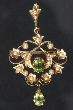 ART NOUVEAU PENDANT 15ct yellow gold with 2 peridots and 19 Orient pearls.