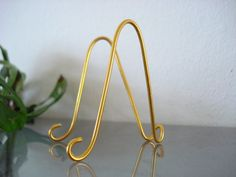 "25 pk Large GOLD MINI  Easel Stand Holder FOR 5"" x 7"" Table Name Holders Photo Card Art Holder Place Card Business Card Promotion Display by soami on Etsy https://www.etsy.com/uk/listing/504837291/25-pk-large-gold-mini-easel-stand-holder"