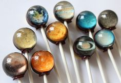 Solar System Lollipops – The Colossal Shop:Go on a voyage through our sweet solar system which tastes surprisingly delicious. These 10-piece lollipop sets are completely edible and include images of the Sun, Mercury, Venus, Earth, Mars, Jupiter, Saturn, Uranus, Neptune and Pluto (Yes, Pluto. Take that Mike Brown!). A flavor card is included with each pack along with a planet ID card so you know which planet you are enjoying.