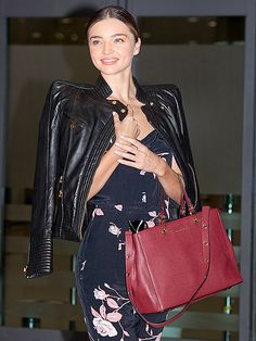 Miranda Kerr sports the cure for the cold shoulder on Monday as she arrives at Incheon International Airport