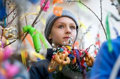 A boy carries traditionally decorated catkin twigs during a Palm Sunday procession in Lofer, Austria on April 1, 2012.
