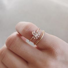 Rose gold morganite pear cut ring with diamond halo, by Natalie Marie Jewellery