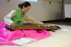 a Gayageum plaid during a Korean Buddhist matcha tea ceremony.  Taken by Gaby at the PennState Korean Tea Exhibition.