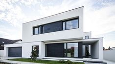 C House: Black and White Volumes in a Modern Home in Romania