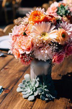 Stunning orange wedding centerpiece; Photography: Jen Rodriguez