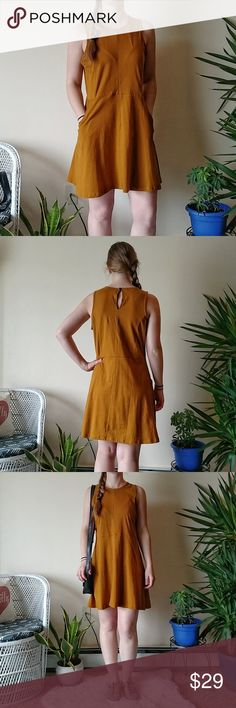 "*Like New* Elevation Trade Mustard Cotton Dress Elevation Trade 100% Organic Cotton and Fair Trade mustard yellow dress with pockets!  - Super comfortable and light weight - This dress is like new and showing no wear - Has pockets and small key-hole back with button - I'm 5'4"" and this hits a few inches above the knee - Size small, but fits more like a size medium. I am a size 4 in dress and this hangs loose on me - Slight hourglass shape to the dress Elevation Trade Dresses Mini"