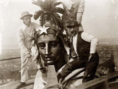 This picture was taken in 1909. It shows three men on the top of the US Capitol dome in Washington DC. They look like they are installing or...
