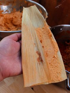 Red Pork Tamales (or Tamales de Puerco en Chile Rojo) is traditional Mexican food at its best. So tasty. So incredibly delicious. They are worth the effort to make. With VIDEO and step-by-step tutorial. By Mama Maggie's Kitchen Mexican Soup Recipes, Mexican Dishes, Raw Food Recipes, Pork Recipes, Cooking Recipes, Mexican Desserts, Freezer Recipes, Drink Recipes, Cooking Tips