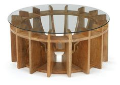 Geometric wooden coffee table with a glass top. Architectural, sleek lines give great dimension and interest to this dial or gear shaped side table. See our listings for the matching side or console t
