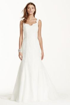 Delicate and timeless, this feminine lace trumpet gown is truly breathtaking!  Tank bodice features all over stunning lace applique detail.  Tulle trumpet skirt adds jus tthe right amount of flare.  Chapel train. Sizes 0-14.  Available in stores and online in Ivory.  Fully lined. Back zip. Imported polyester. Dry clean.  To preserve your wedding dreams, try our Wedding Gown Preservation Kit.