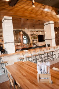 Downstairs bar with subway tile columns