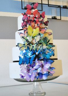 Great cheap wedding cake idea - buy a plain cake and top it with your own edible decorations, or some that you bought off of etsy.