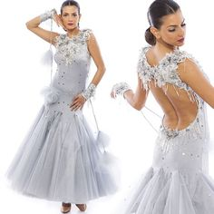 Silver ballroom gown , beaded flower details and puffy pom poms for a fun accessory on the dance floor ❄❄❄ #dancesport #dancecostume #ballroomdresses #dancing #icequeen #coutureclothes #sasuel