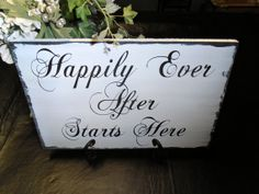 I like this one to set on a table bc it sits higher  Happily Ever After Starts Here Wood Wedding Sign by Nesedecor, $24.00