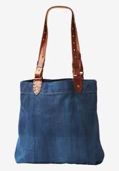 Easy tote in supple, indigo-dyed, washed Japanese denim. Zip fastening. Internal, zipped pocket. Wide, adjustable straps in a sturdy calf leather. Aged brass fitments. Hand made by Nivaldo de Lima in Spain.