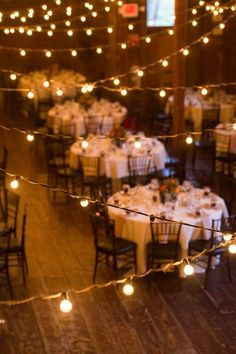 Bistro lights add a fun and romantic addition to wedding reception decor {Misty Enright Photography}